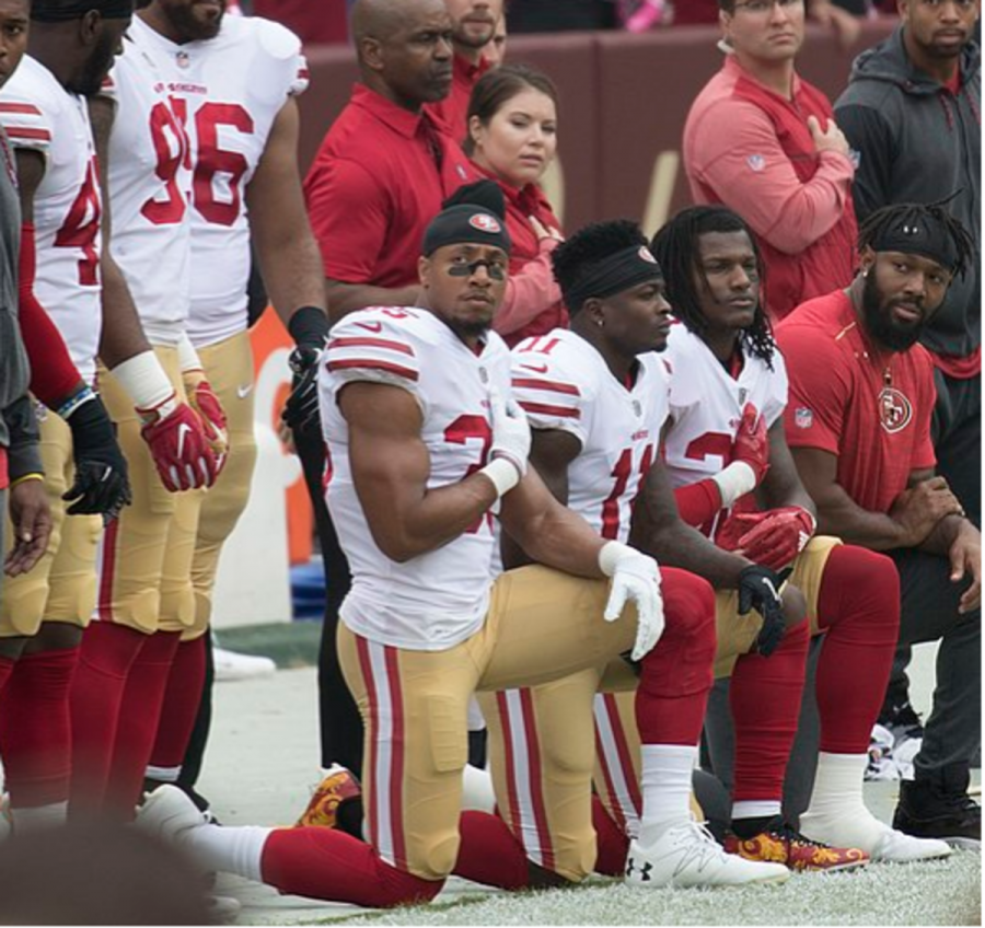 Some+members+of+the+San+Francisco+49ers+kneel+during+the+National+Anthem+before+a+game+against+the+Washington+Redskins+at+FedEx+Field+on+October+15%2C+2017+in+Landover%2C+Maryland.