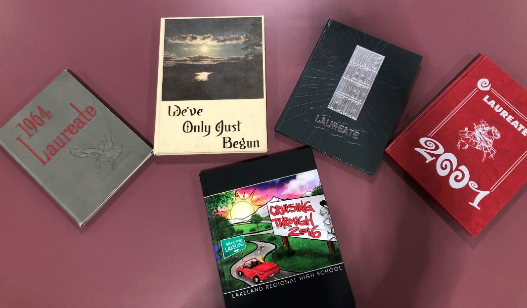 Some of Lakeland's past yearbooks, which give former students a means to revive their high school  years.