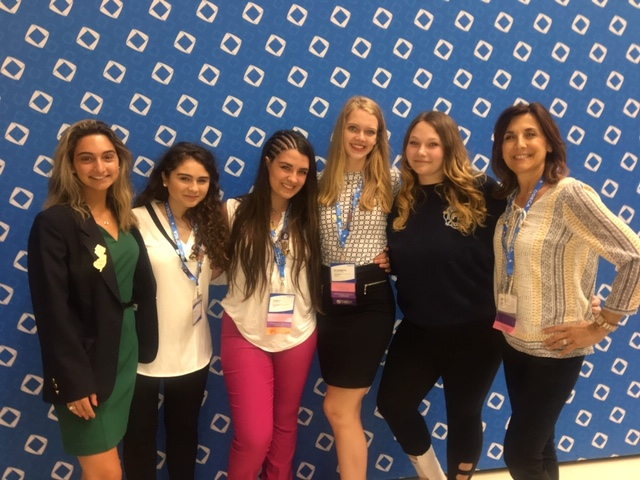 DECA+members+Hailey+Imbasciani%2C+Sarah+Panicucci%2C+Carly+Malfatto%2C+Liz+Macioworski%2C+and+Heidi+Jones+pose+with+club+adviser+%0AOrnella+Incardona+at+the+ICDC.