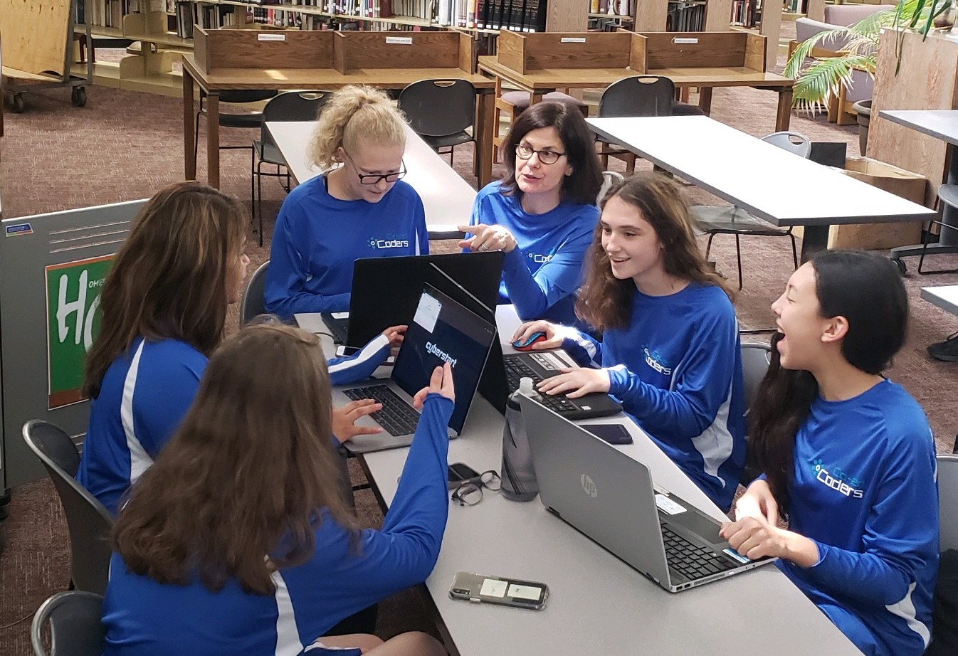 Girls from the Co-ed Coders club, working with adviser Ms. Pagano, make their way to nationals of the Girls Go CyberStart competition.