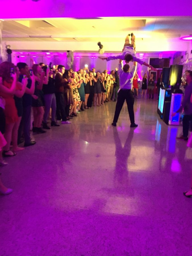 Students show off their school spirit and dance moves at the dance.