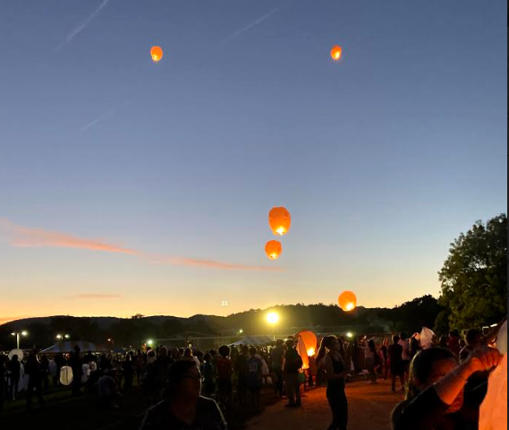 The sale of each lantern at the 2019 Wanaque Day went to benefit OASIS, a charity for woman and children in need. LRHS DECA students Shannon Broderick and Elisabeth Phillips ran the event.