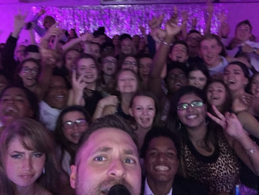 Mr. Novak in one of his trademark selfies with students at the Homecoming Dance!