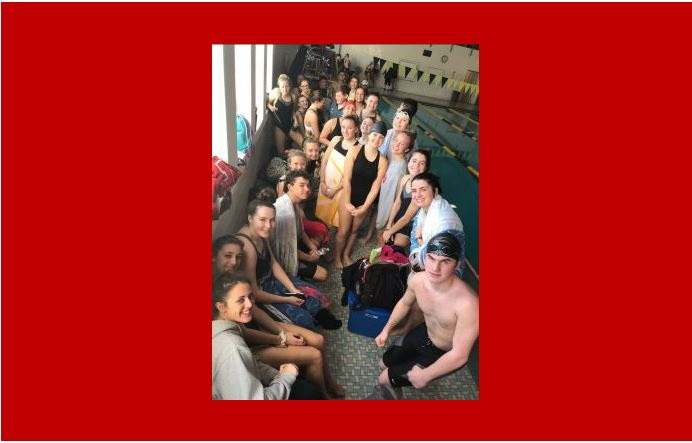 LRHS and WMHS swim team pose for a photo showing unity between the rival schools.