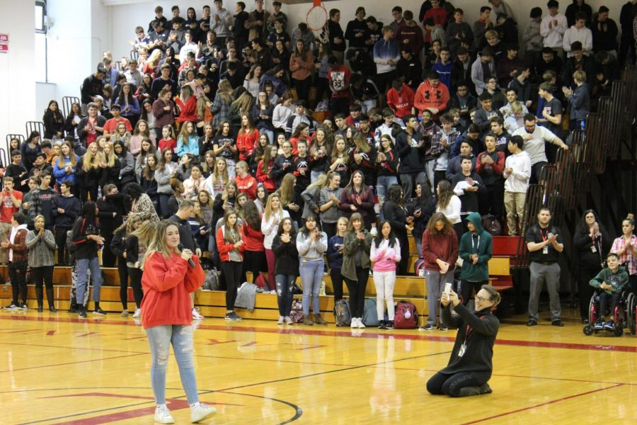 Kaylin+Ponce+singing+the+national+anthem+to+the+student+body.