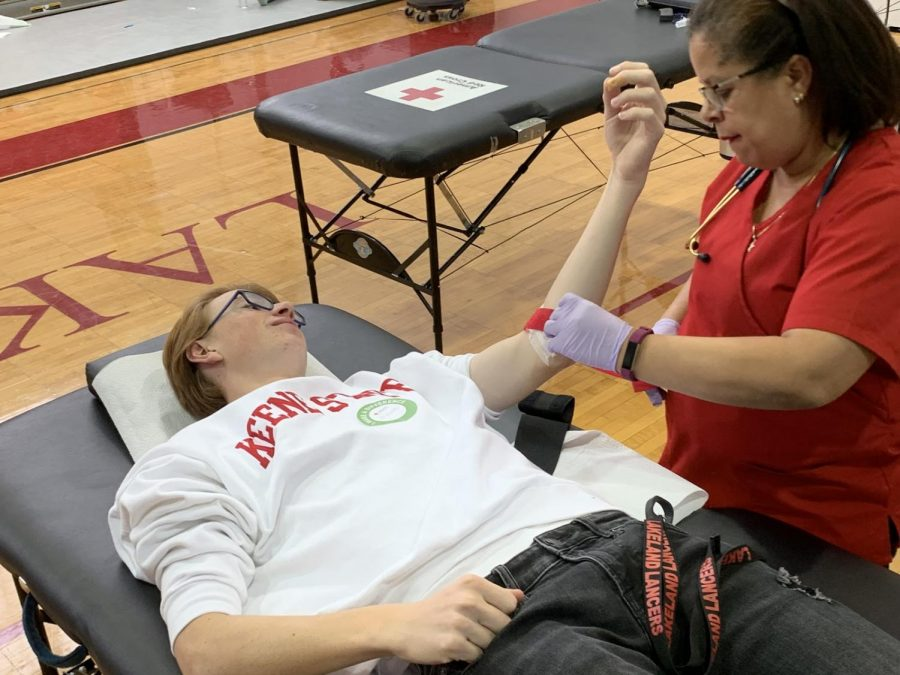Senior Evan Carus gives back to his community by donating blood.