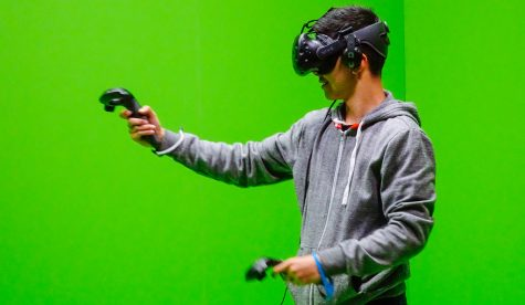For gamers, now is the time to consider purchasing a VR system, like the one pictured here (HTC Vive VR headset with 2 controllers).