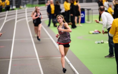 Angelina Perez's success didn't end in the fall season - here she is pictured in the lead at an indoor meet.