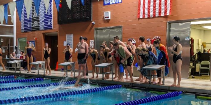 Swimmers competing at their winning meet against Passaic.