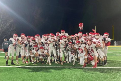 The team celebrating their victory over West Milford, the last game of the season. They took home the Trends Cup, a rivalry trophy between the two teams.