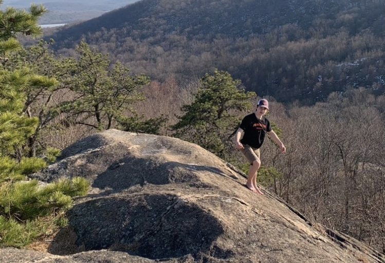Senior Ben Kopacki soaking in the sun and hiking in the mountains of Ringwood last summer.