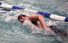 Owen Schouten broke two school record in boys swimming both the 200 IM and the 100 free.